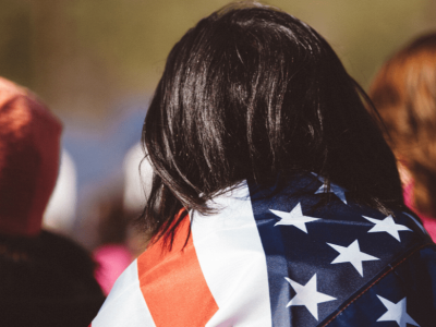 A girl with an American flag wrapped around her.