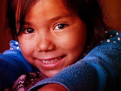 A small girl smiles.